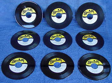Specialty label - (9) Reissued 45's